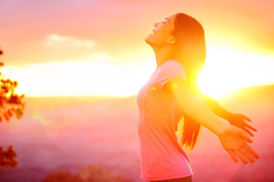 Free happy woman enjoying nature sunset. Freedom, happiness and